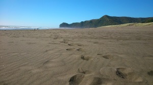Punishing soft sand on Piha Beach